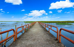 Jetty at lake and blue sky in tropical country southern of Thail. And Royalty Free Stock Photo