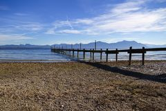 Jetty at lake Chiemsee Royalty Free Stock Images