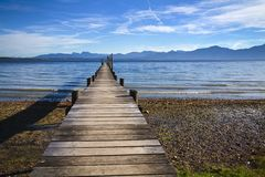 Jetty at lake Chiemsee Stock Images