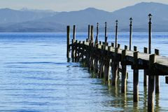 Jetty at lake Chiemsee Stock Image