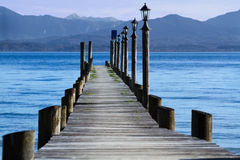 Jetty at lake Chiemsee Royalty Free Stock Photos