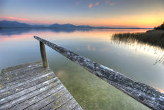 Jetty at lake chiemsee. Close to the alps Royalty Free Stock Image