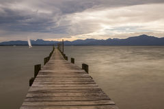 Jetty at lake Chiemsee in Bavaria, Germany Royalty Free Stock Photo