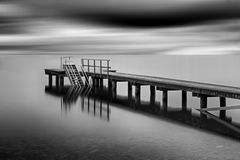 Jetty on lake Chiemsee, Germany Stock Images