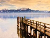Jetty on lake chiemsee Stock Photos