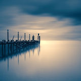 Jetty on a lake with dramatic sky Stock Image