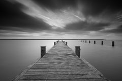 Jetty at lake Markermeer in black and white. Stock Photography
