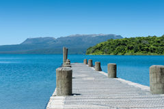 Jetty, Lake & Mountain - Tarawera Stock Image