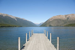 Jetty on Lake Rotoiti with mountain view. Jetty on Lake Rotoiti in the Nelson Lakes District with mountains, South Island, New Zealand Stock Photo