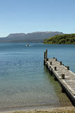 Jetty on lake Stock Photography