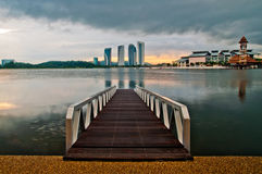 Jetty at lakeside with colorful sunrise. Pullman, Putrajaya, Malaysia Royalty Free Stock Images
