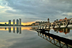 Jetty at lakeside with colorful sunrise. Pullman, Putrajaya, Malaysia Royalty Free Stock Photography