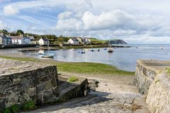 Peaceful Place. A jetty leading down to the water at the peaceful village of Parrog, near Newport, Pembrokeshire, Wales Royalty Free Stock Photo