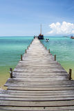 Jetty that leads to an tropical island. And sky Stock Image