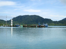 Jetty with lighthouse. And fishing boat at Koh Chang, Trad, Thailand Royalty Free Stock Images