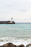 Jetty with lighthouse in Yalta city Royalty Free Stock Photography