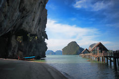 Jetty and longtail boat. At Tapu island , Jame bond island, Phang nga, Southern of Thailand stock photo