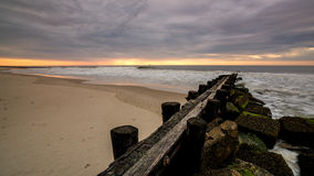 Jetty made of wood along the Atlantic Ocean Stock Images