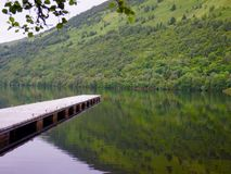 Jetty made of wood in scotland. At a loch Royalty Free Stock Image