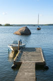 Jetty with moored leisureboat Finland Stock Image