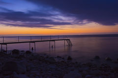 Jetty in nighttime on northsealand costline Royalty Free Stock Images