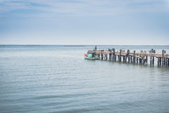 Jetty outstretched to the sea. With both and blue sky Royalty Free Stock Photo