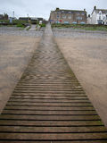 Jetty over sandy beach Royalty Free Stock Image