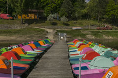 Jetty and pedal boats. Jetty and empty pedal boats on the lake in Roznow , Poland. Europe Stock Image