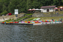 Jetty and pedal boats. Jetty and empty pedal boats on the lake in Roznow , Poland. Europe Stock Photography