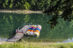 Jetty and pedal boats. Jetty and empty pedal boats on the lake at Solina , Poland Stock Photo