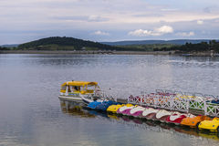 Jetty and pedal boats Stock Images