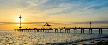 Jetty with people at sunset Royalty Free Stock Images