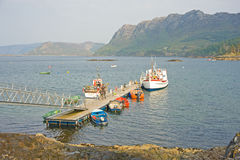Jetty at Plockton harbour. Royalty Free Stock Photo