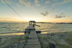 Jetty with relaxing tourist at dusk Royalty Free Stock Images