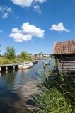 Jetty with rowingboat Grisslehamn Sweden Stock Photos