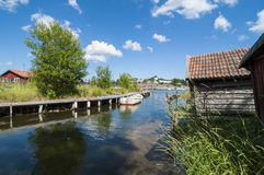 Jetty with rowingboat Grisslehamn Sweden Royalty Free Stock Photos
