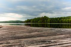 A jetty on the Saimaa lake in the Kolovesi National Park in Finland at sunset - 2 royalty free stock photography