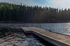 A jetty on the Saimaa lake in the Kolovesi National Park in Finland at sunset - 1 stock image