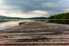 A jetty on the Saimaa lake in the Kolovesi National Park in Finland at sunset - 3 royalty free stock images