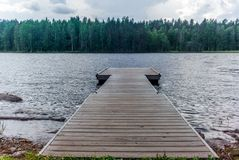 A jetty on the Saimaa lake in the Kolovesi National Park in Finland at sunset - 5 royalty free stock photography