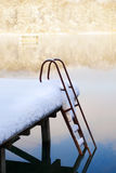 Jetty with scale under snow Royalty Free Stock Photography