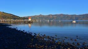 Jetty and scenic bays of Akaroa. Banks Peninsula in New Zealand Royalty Free Stock Photo