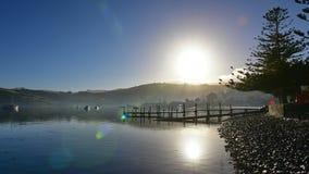 Jetty and scenic bays of Akaroa, Banks Peninsula. In New Zealand Stock Photos