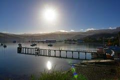 Jetty and scenic bays of Akaroa, Banks Peninsula. In New Zealand Royalty Free Stock Photo