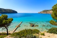 Jetty sea horizon beach bay mountains. Camp de Mar, Majorca island, Spain Royalty Free Stock Photography
