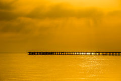 Jetty silhouette at. Royalty Free Stock Image
