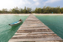 Jetty and small boat at Koh Rong island, Cambodia, South East  Royalty Free Stock Images