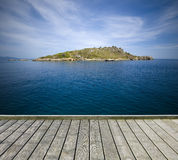 Jetty with small island Royalty Free Stock Image