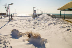 Jetty on a snow-covered promenade of Pomorie in Bulgaria, winter Royalty Free Stock Image