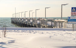 Jetty on a snow-covered promenade of Pomorie in Bulgaria, winter 2017 Royalty Free Stock Images